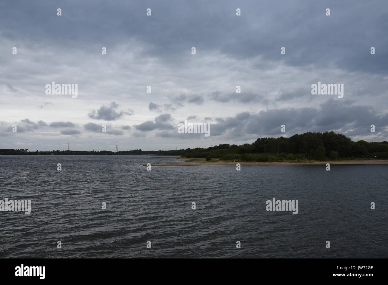 A stormy looking morning across Chasewater Country Park, Stafordshire, UK with cloud building and the threat of rain. Typical for a Great British summer holiday - Stock Image