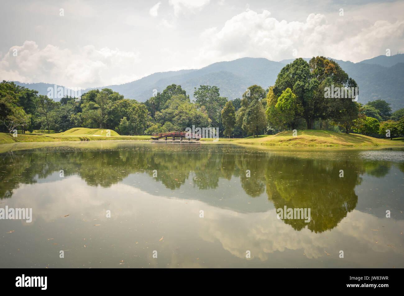 Beautiful landscape of water reflections in Taman Tasik, aka Lake Gardens, in the city of Taiping, Perak State, Malaysia - Stock Image