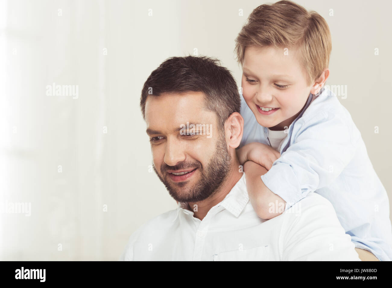 little son with young father spending time at home - Stock Image