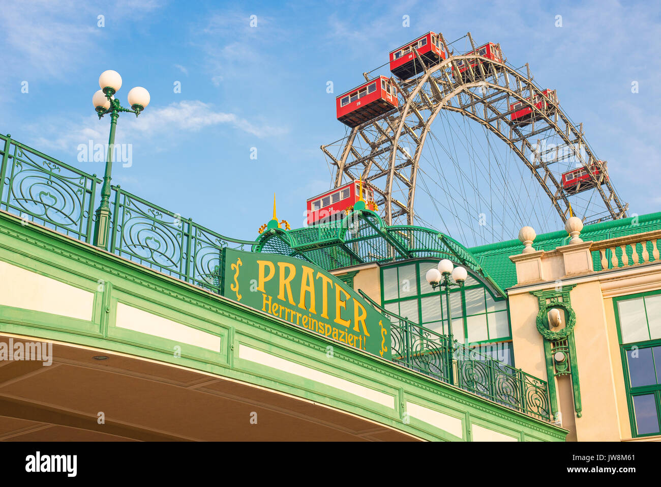 Vienna Prater park, the entrance to the Prater amusement park in Vienna with the famous Riesenrad ferris wheel in the background, Austria. - Stock Image