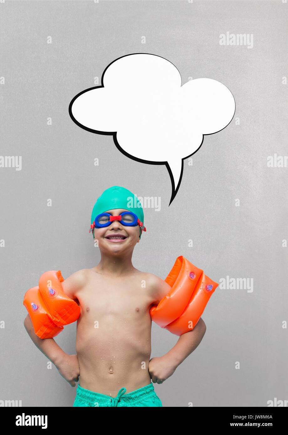 a7e5cdbf8b4 Digital composite of Boy with speech bubble ready to swim against grey  background - Stock Image