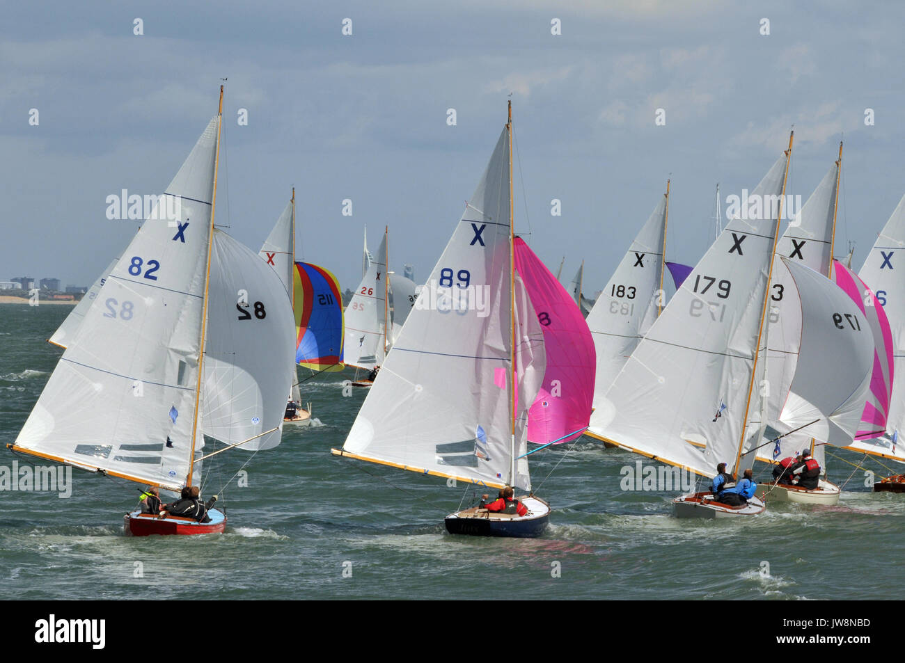 Cowes week atmosphere lends property sponsors yachts an yachting regattas royal yacht squadron crowded streets and party's summer seaside holiday - Stock Image