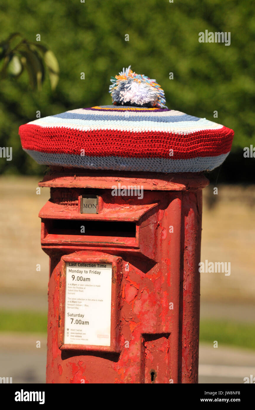 Royal mail post office christmas stock photos royal mail post a post box wearing a knitted wooly hat for christmas seasonal greetings xmas fun royal mail m4hsunfo