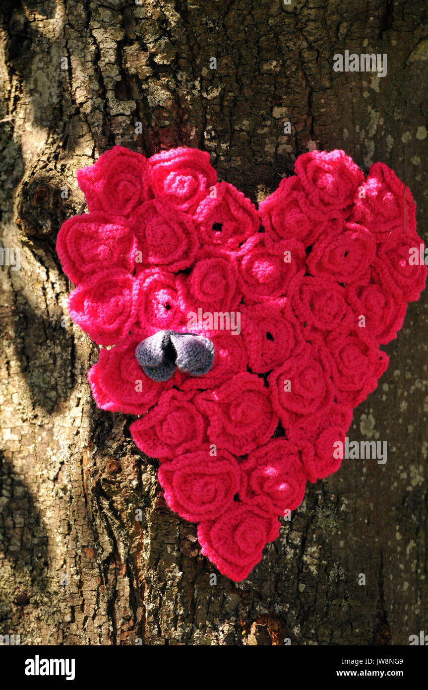 A Heart Knitted From Small Red Roses And Pinned To A Tree Knitting
