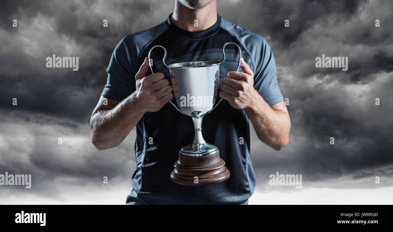 Digital composite of Man with a trophy on hands - Stock Image