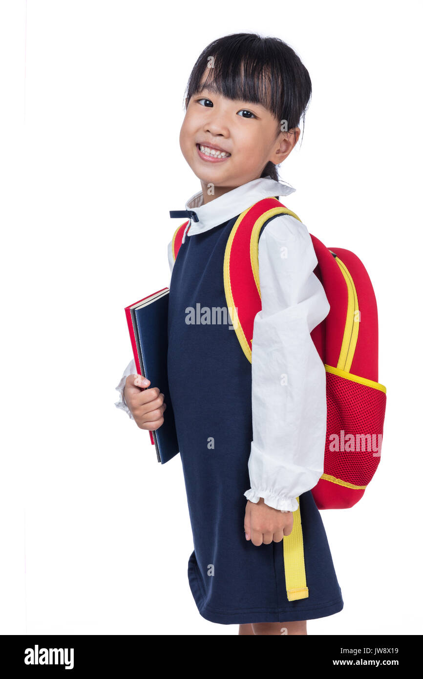 edc551aa093 Asian Little Chinese girl in school uniform with school bag in isolated  white background