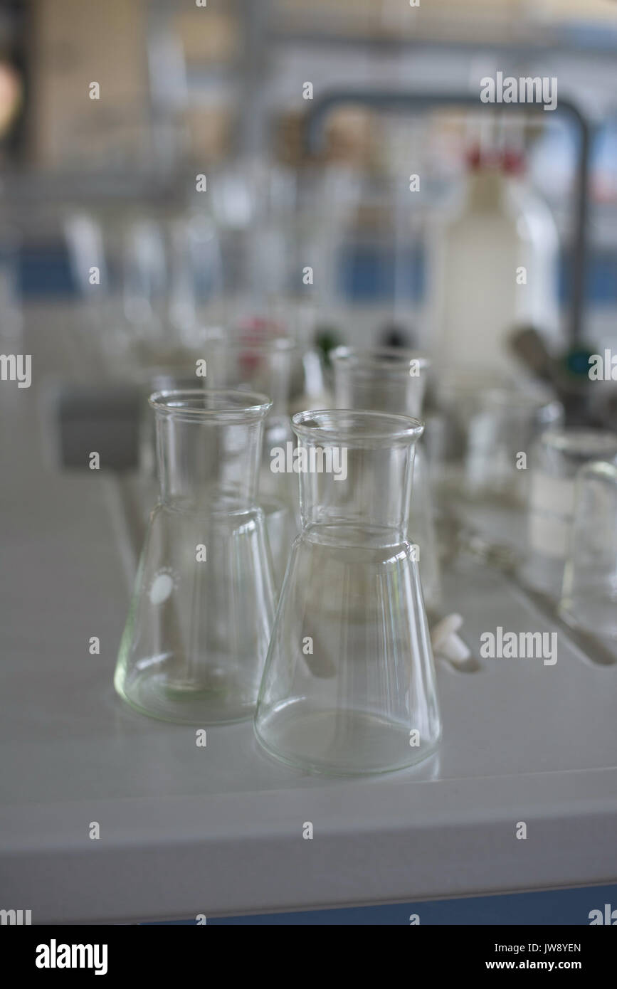 High angel view of beakers on desk in lab - Stock Image