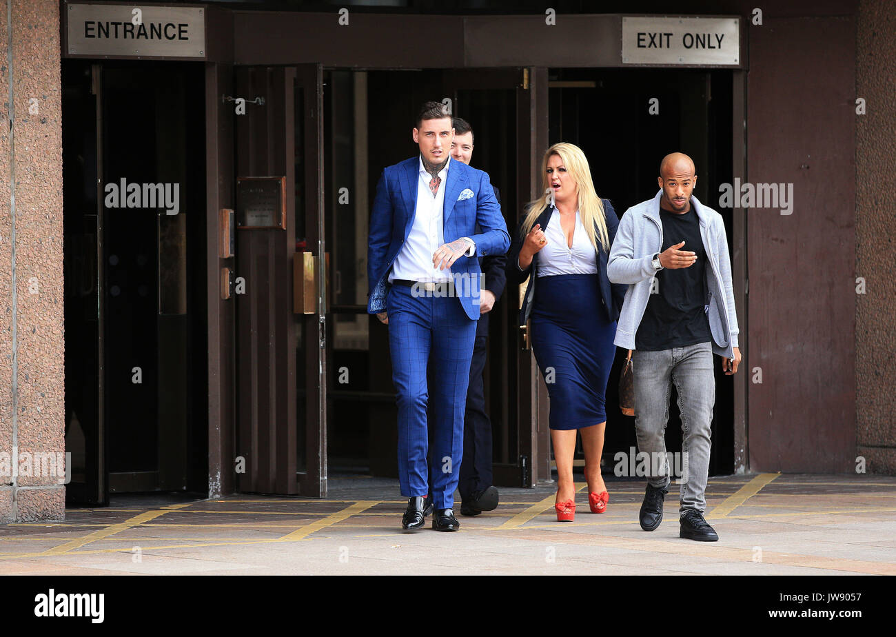 Jeremy McConnell (left) leaves Liverpool Magistrates Court after