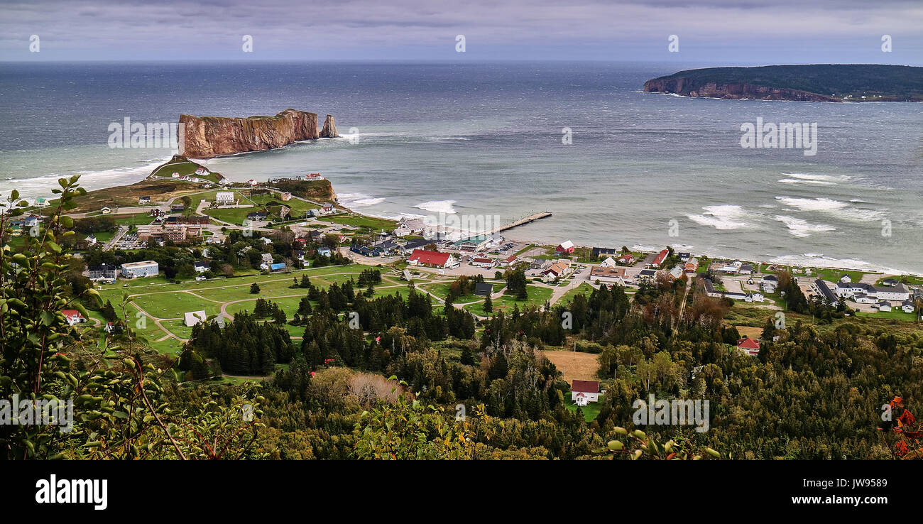 America, Canada, Québec, Gaspésie, Percé city,  coast, Perce rock is a huge sheer rock formation in the Gulf of Saint Lawrence on the tip of the Gaspe Peninsula in Quebec, Canada, off Perce Bay. - Stock Image