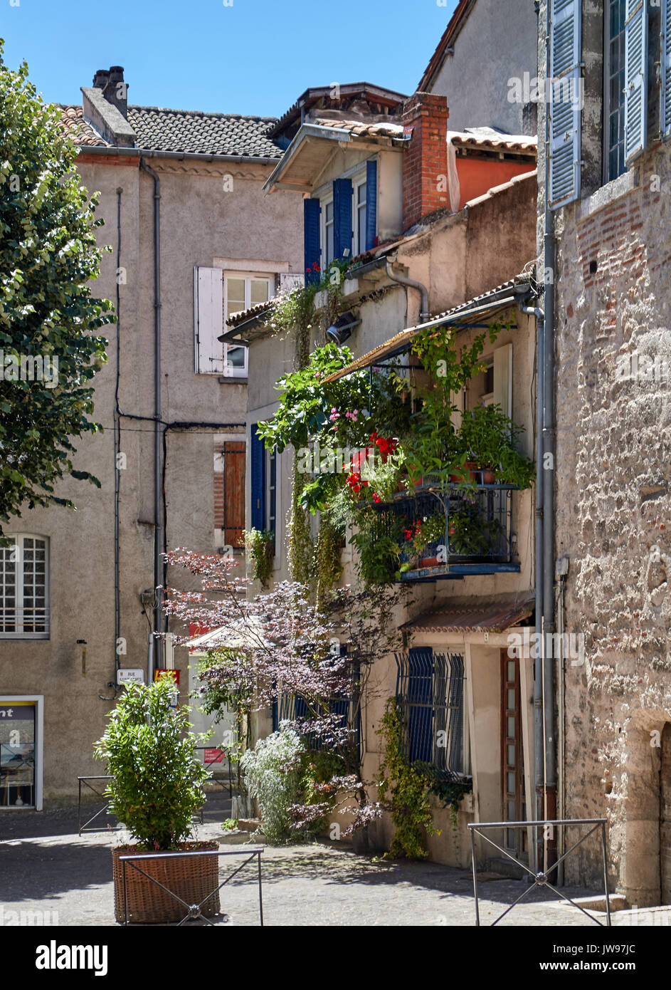 Europe, France, Occitanie, Lot, Cahors city, the old city, timber framed and brick buildings and square in medieval town, Balcony with flowers - Stock Image