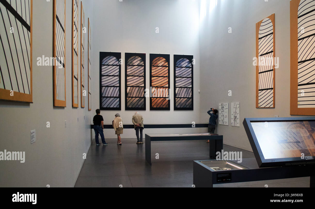 Europe, France, Occitanie,Aveyron,  Rodez city,  Pierre-Soulages museum, The visituer  looks at a painting of the Outrenoirs serie by French painter Pierre Soulages at the Soulages museum - Stock Image