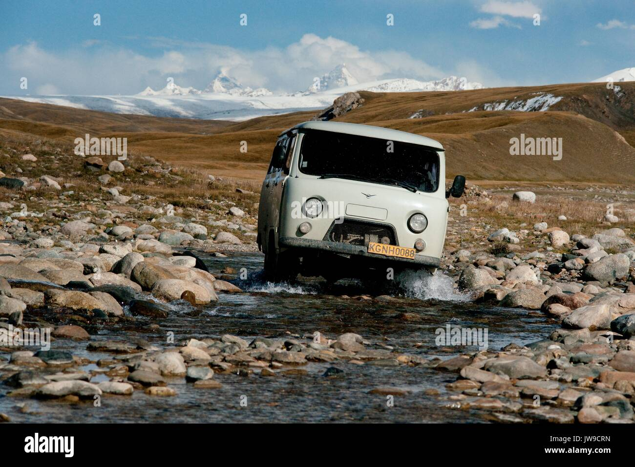 UAZ-452 Russian off road van produced at the Ulyanovsk Automobile Plant cross mountain brook in Kokshaal-Too Kyrgyzstan at the border with China. - Stock Image
