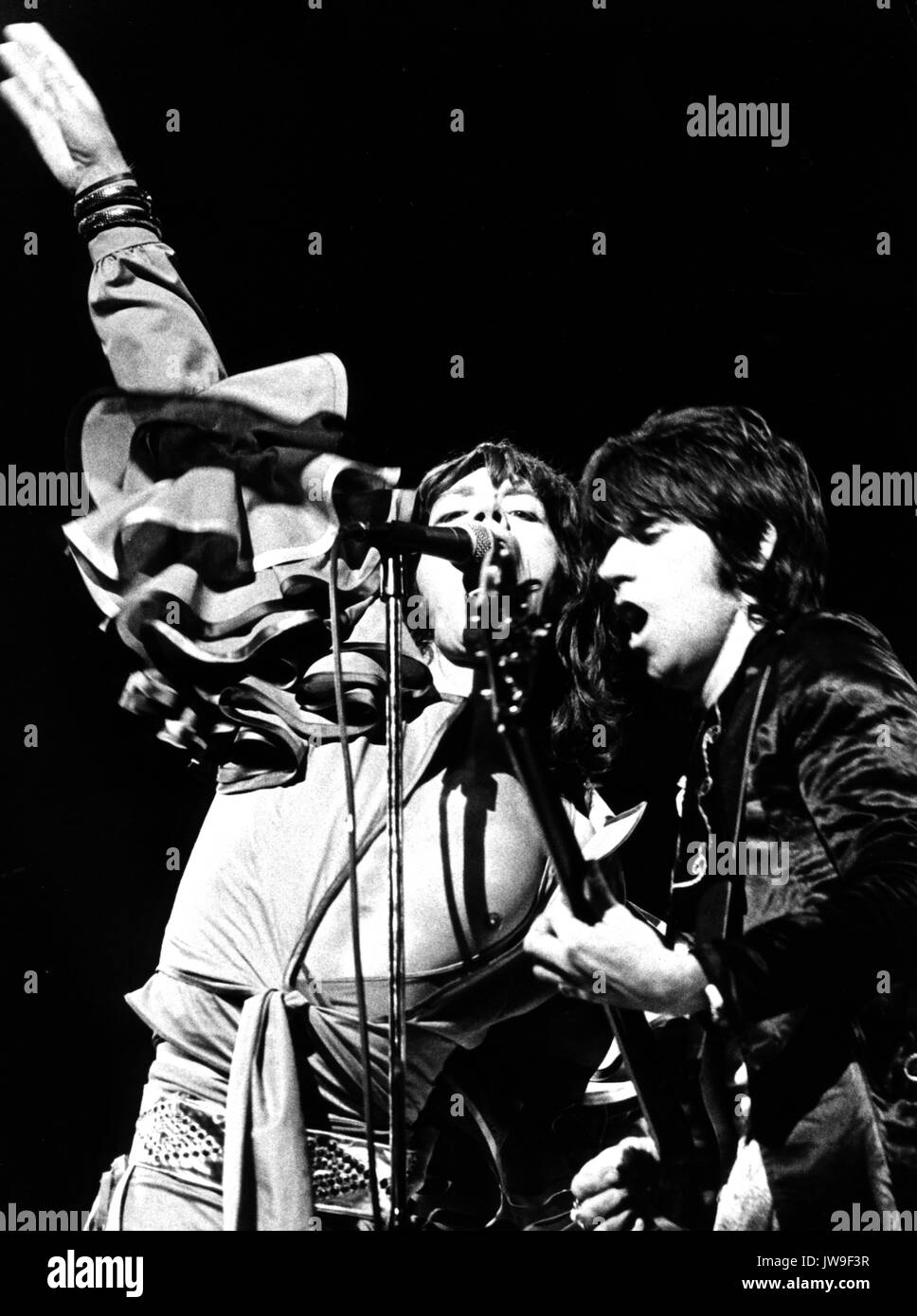 Mick Jagger (l) and Keith Richards on stage. The Rolling Stones on 28 April 1976 at the Festhalle in Frankfurt (Germany). Stock Photo
