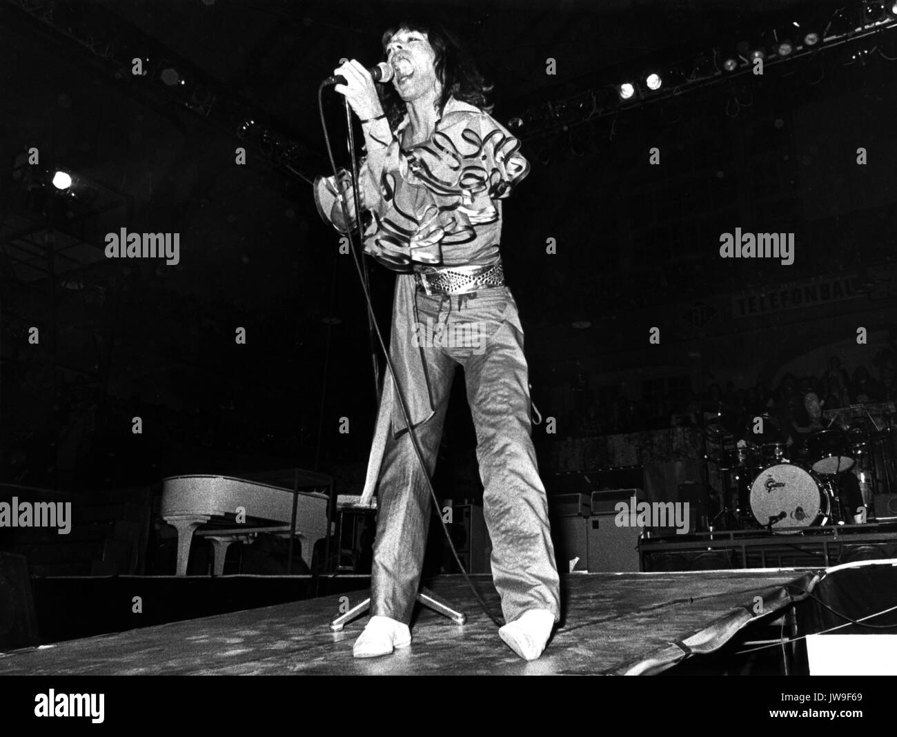 Mick Jagger on stage. The Rolling Stones on 28 April 1976 at the Festhalle in Frankfurt (Germany).   usage worldwide Stock Photo
