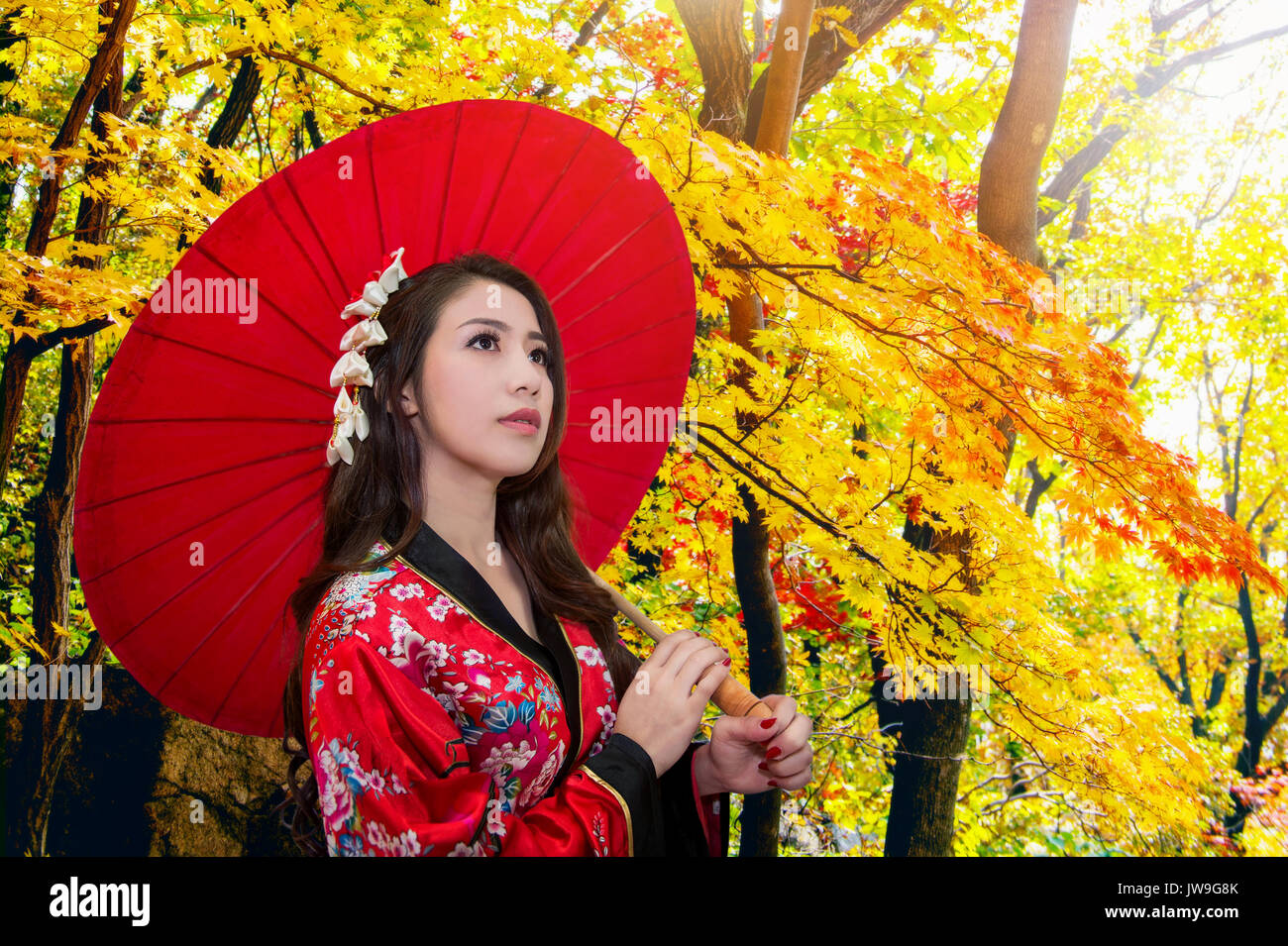 6dfa028dcae57 Asian woman wearing traditional japanese kimono with red umbrella in autumn.