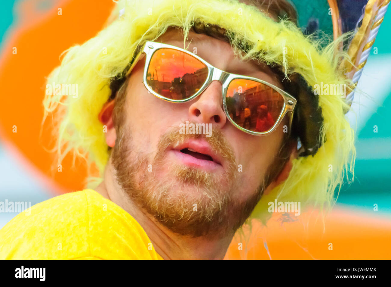 GLASGOW, SCOTLAND - JULY 22, 2017: Performer in the parade travelling through the streets of Glasgow to celebrate The Merchant City Festival - Stock Image