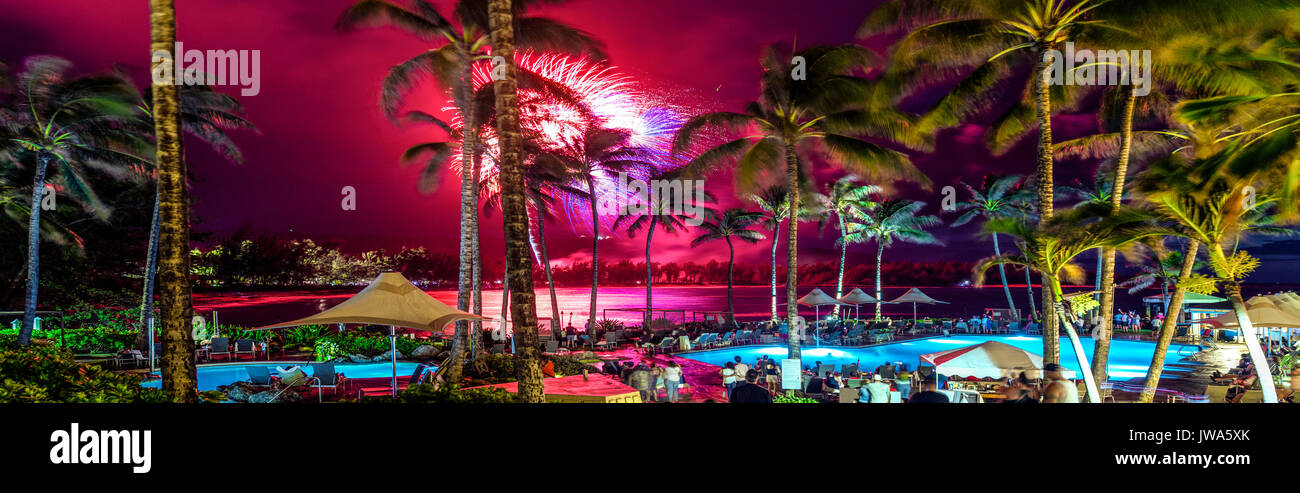 A panoramic view of 4th of July fireworks display at Turtle Bay Resort, on the North Shore of Oahu. - Stock Image