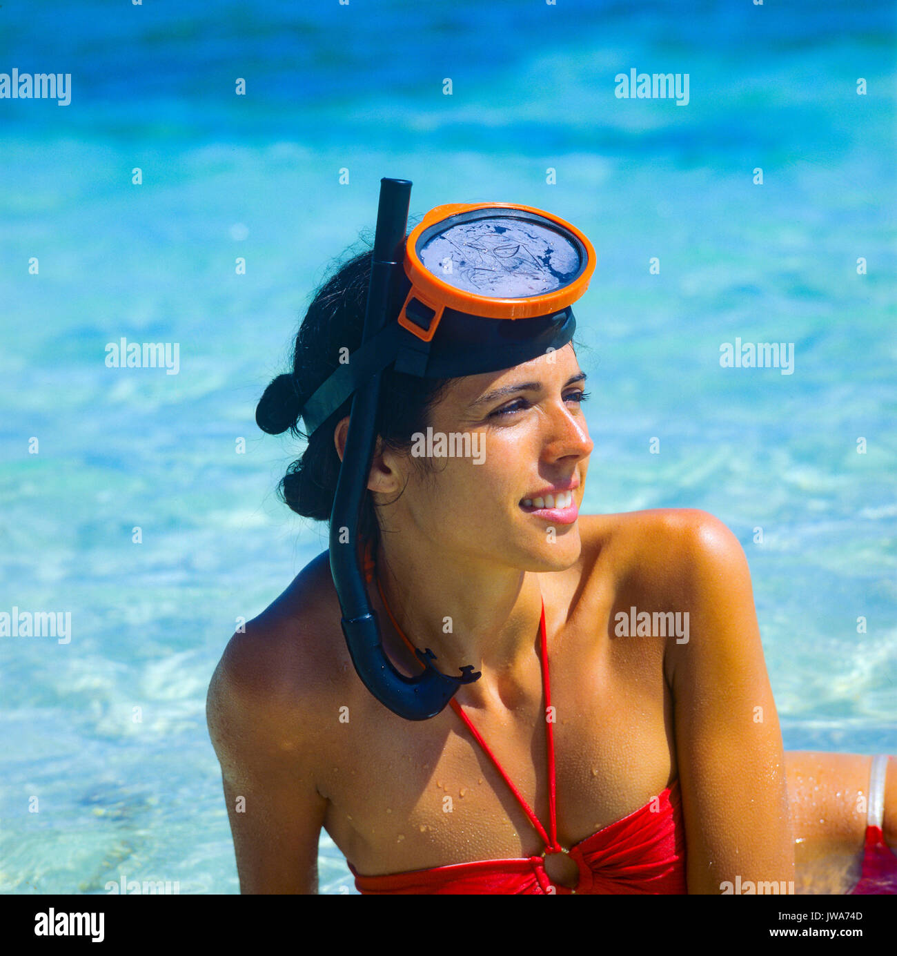Smiling young woman portrait with snorkeling equipment, Caribbean sea, Guadeloupe, French West Indies - Stock Image