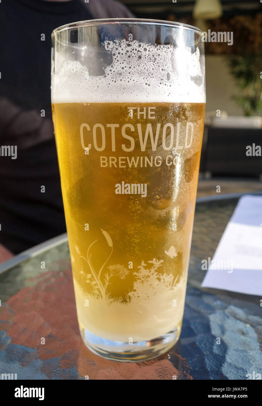 A pint of beer in a pint glass from The Cotswold Brewing Company, England, UK Stock Photo