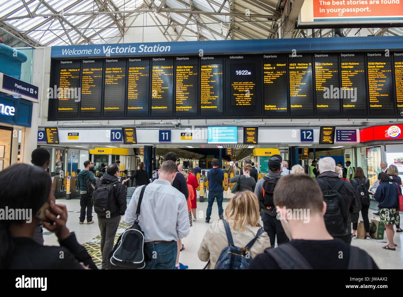 Rail,railway,transport,network,timetable,commute,commuters,Victoria,train,station,London,England,U.K.,UK,Europe. - Stock Image
