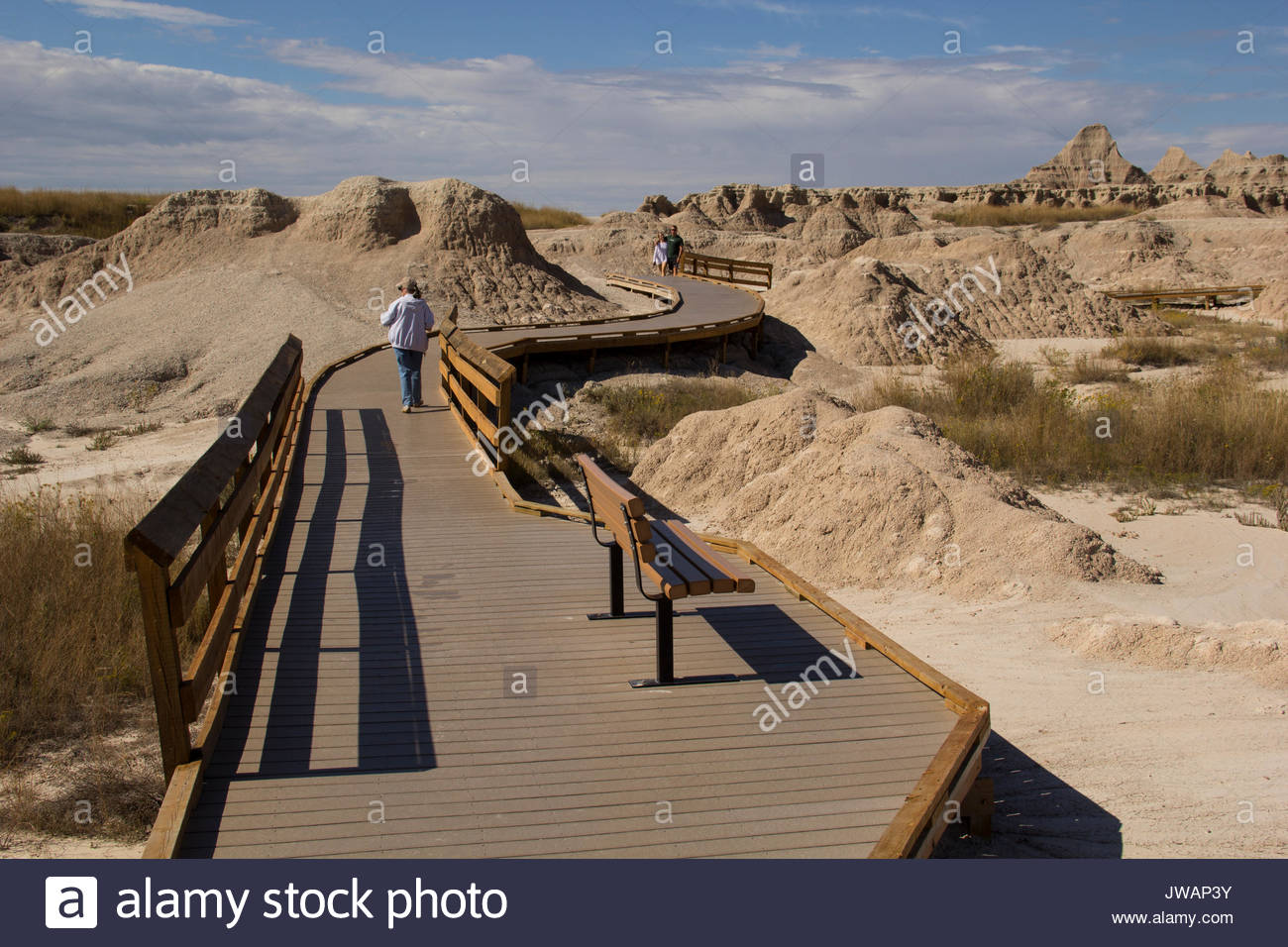 A park walkway offers visitors a closer view of the desert. - Stock Image