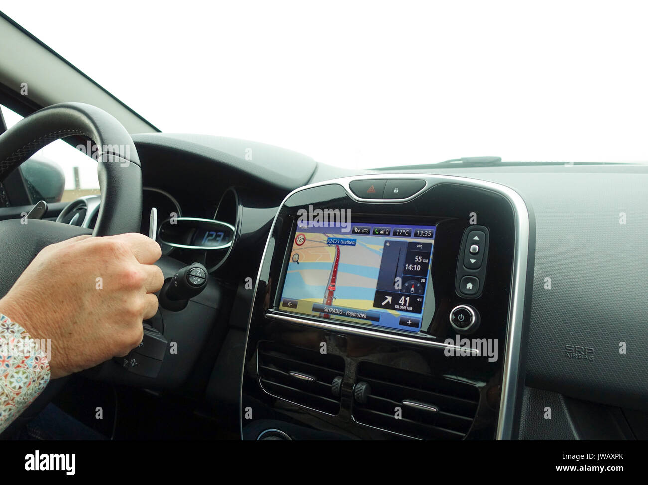 Car navigation system build in interior of modern european car with GPS system on. Netherlands. Stock Photo