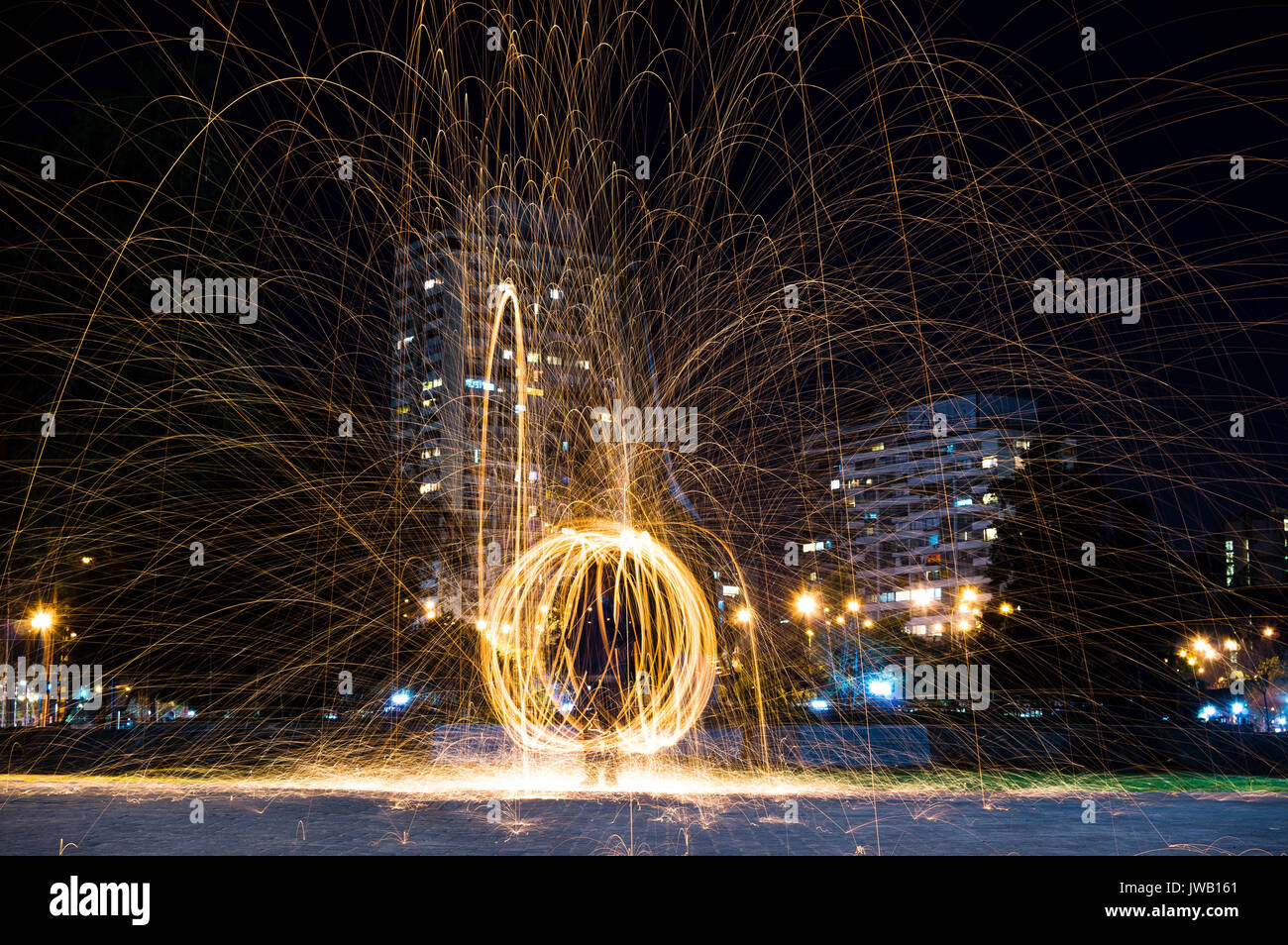 Steel wool light painting in Santiago, Chile Stock Photo