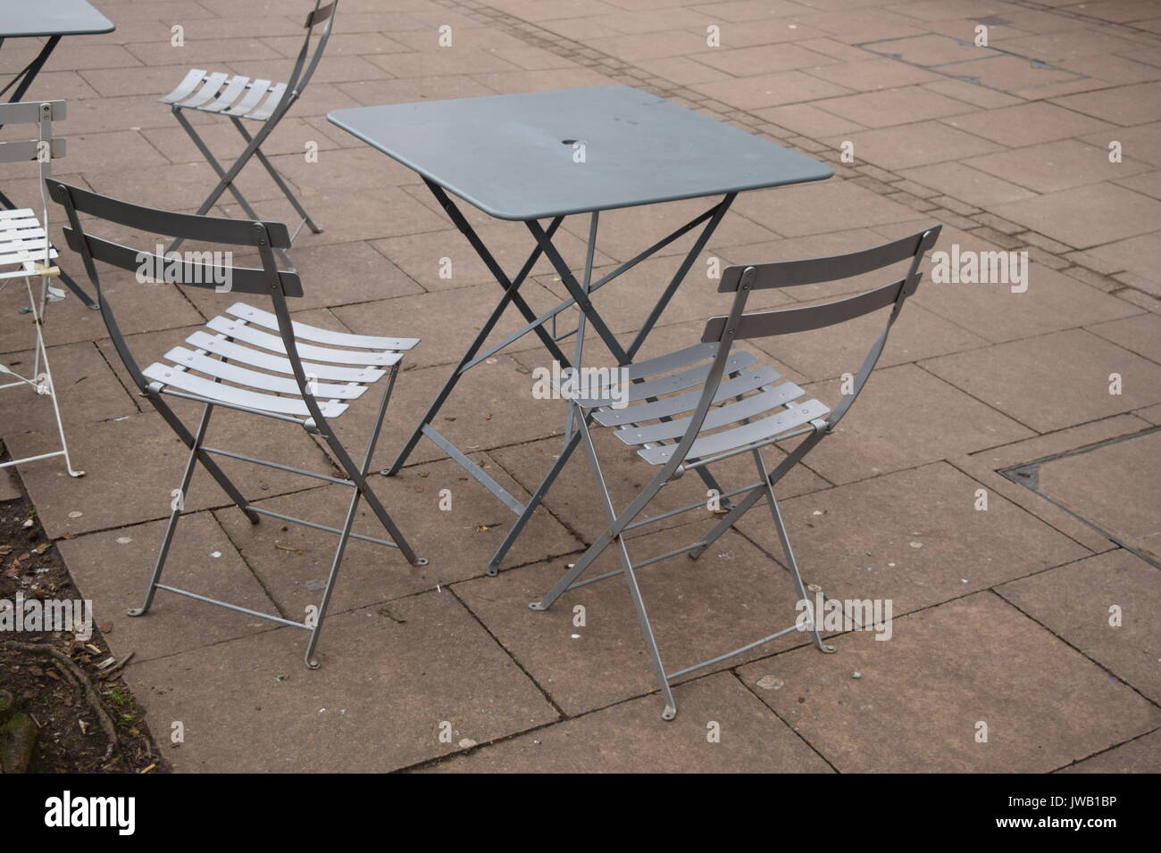 Modern metallic outdoor seating at a cafe Stock Photo