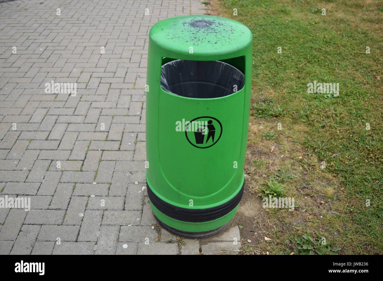 Green bin in the street - Stock Image
