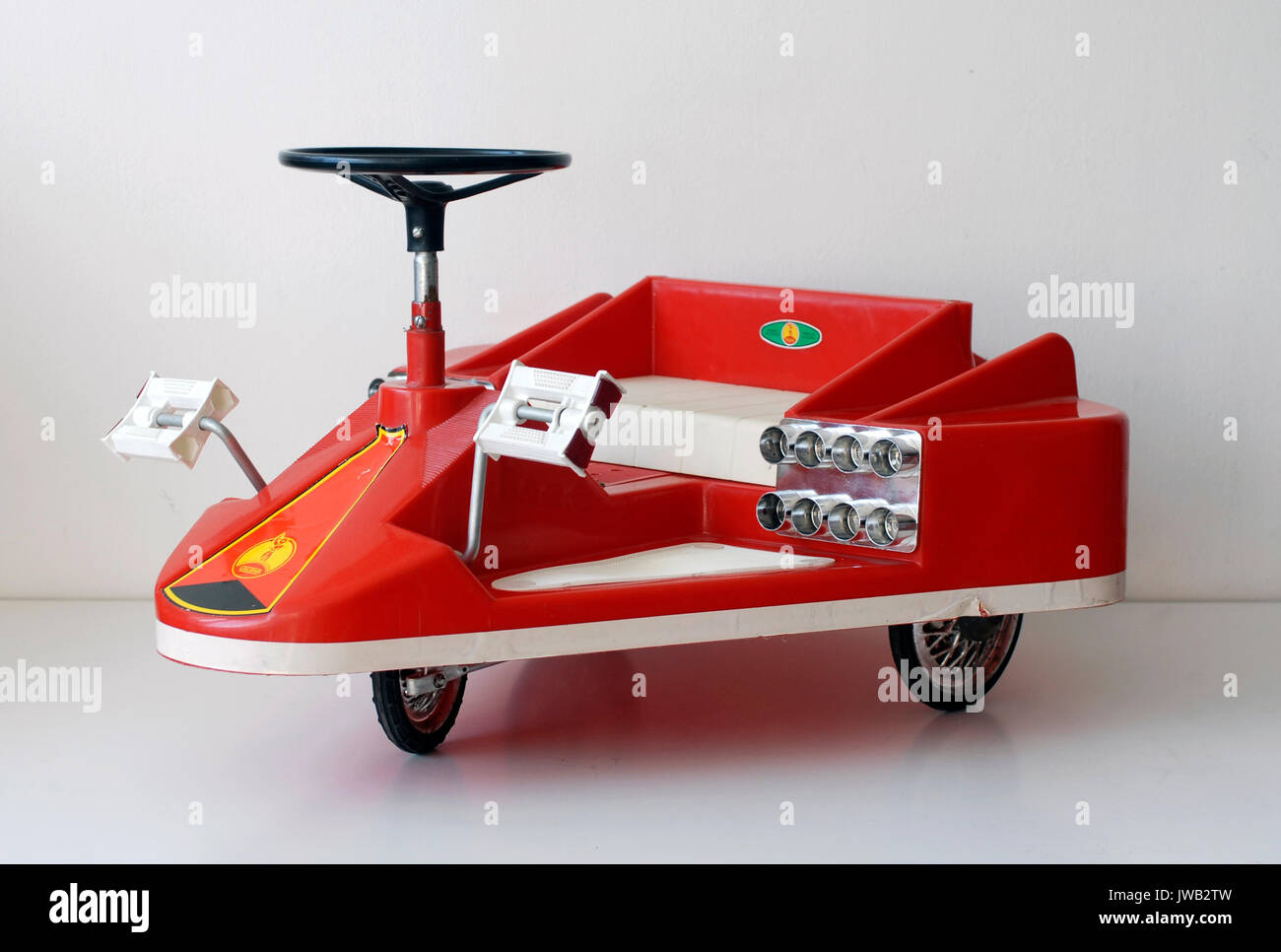 Vintage toy tricycle with spacecraft shape. Coloma, manufactured in Barcelona, Made in Spain - Stock Image