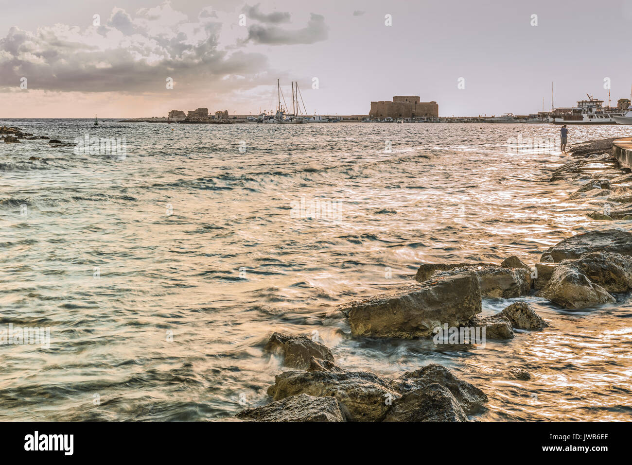 Paphos harbour at sunset. - Stock Image