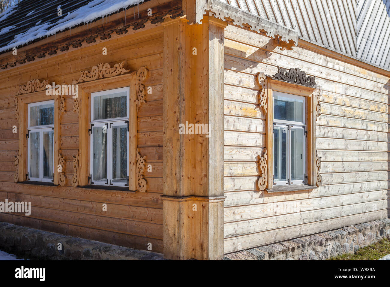 New wooden house wall in traditional carving style - Stock Image
