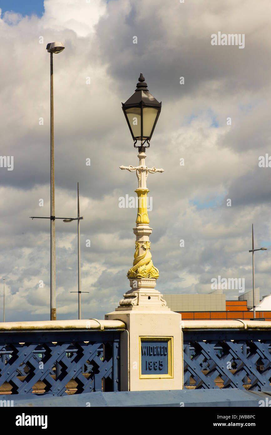 The famous old ornate Victorian gas street lamps that decorate the Queen Victoria Bridge in elfast Northern Ireland. These lamps are cast iron and ar - Stock Image