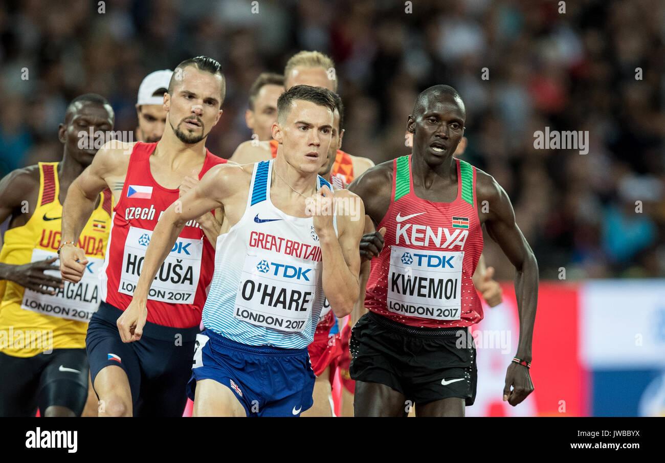Chris O'HARE of GBR leads on the final corner from Ronald KWEMOI (right) of Kenya & Jakub HOLUSA (left) of CZE during the IAAF World Athletics Champio - Stock Image