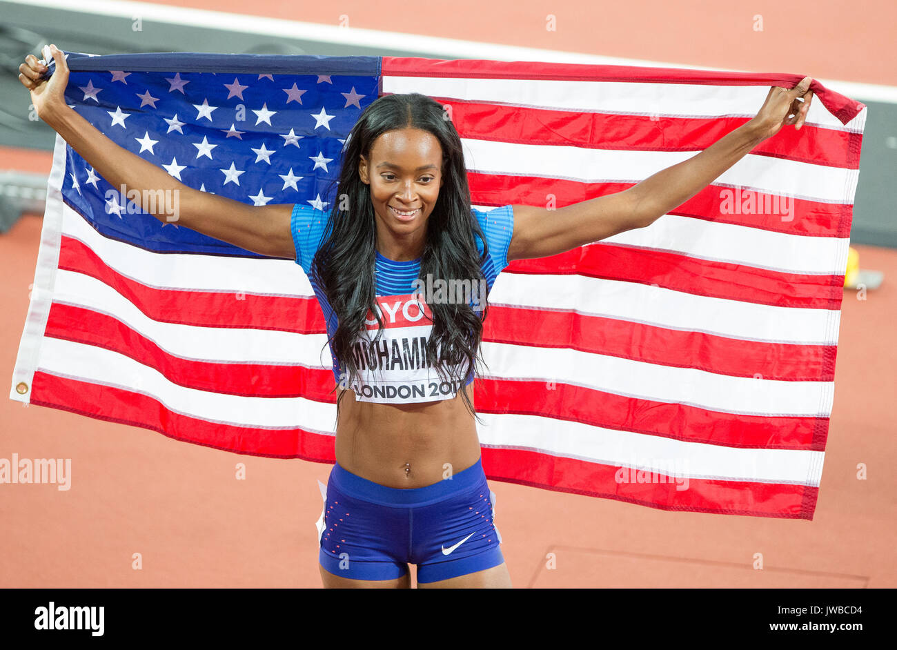 Silver Medalist DALILAH MUHAMMAD of USA poses with the American flag during the IAAF World Athletics Championships 2017 - Day 7 at the Olympic Park, L - Stock Image