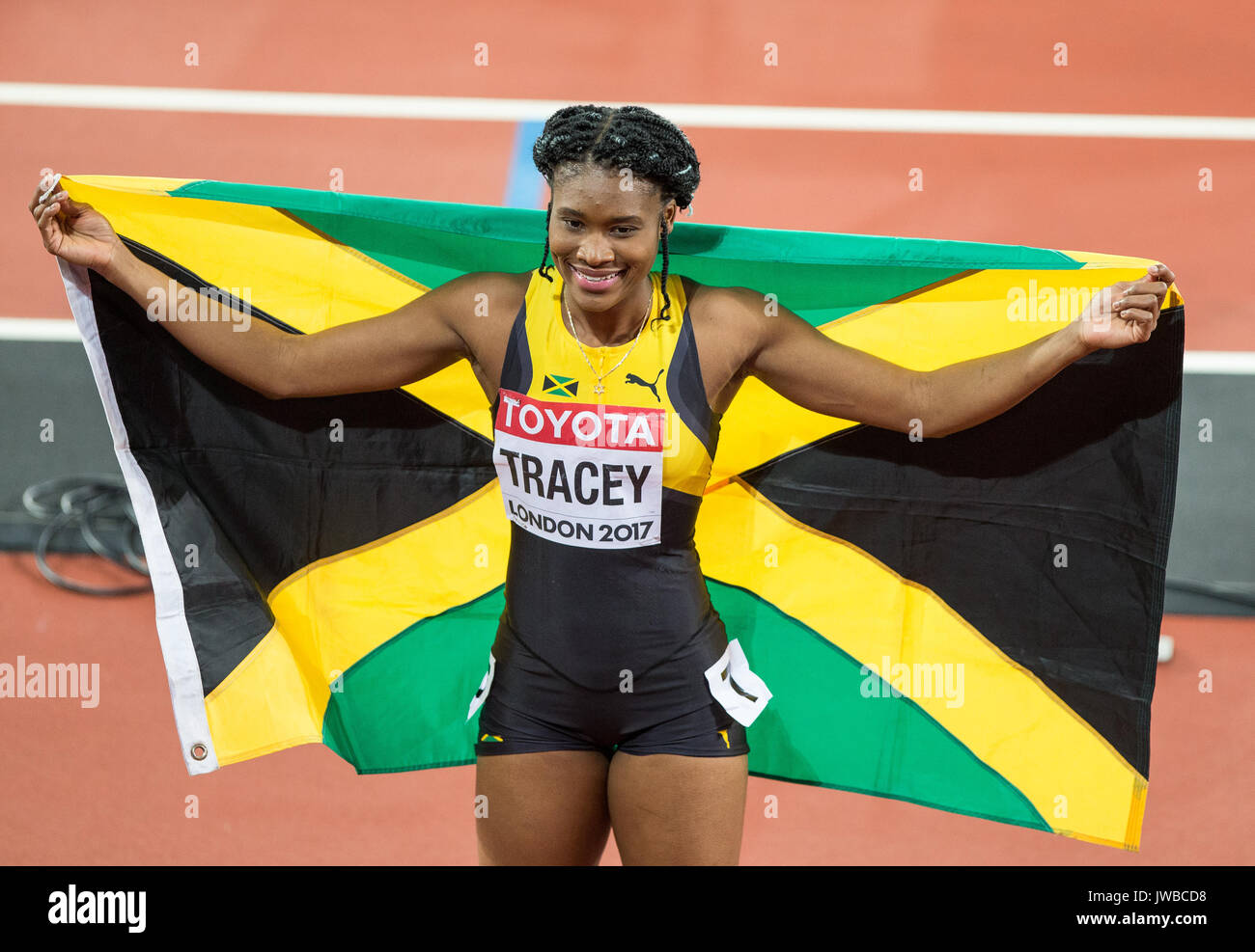 Bronze Medalist RISTANANNA TRACEY of Jamaica pose with the national flag after 3rd in the 400m Hurdles during the IAAF World Athletics Championships 2 - Stock Image