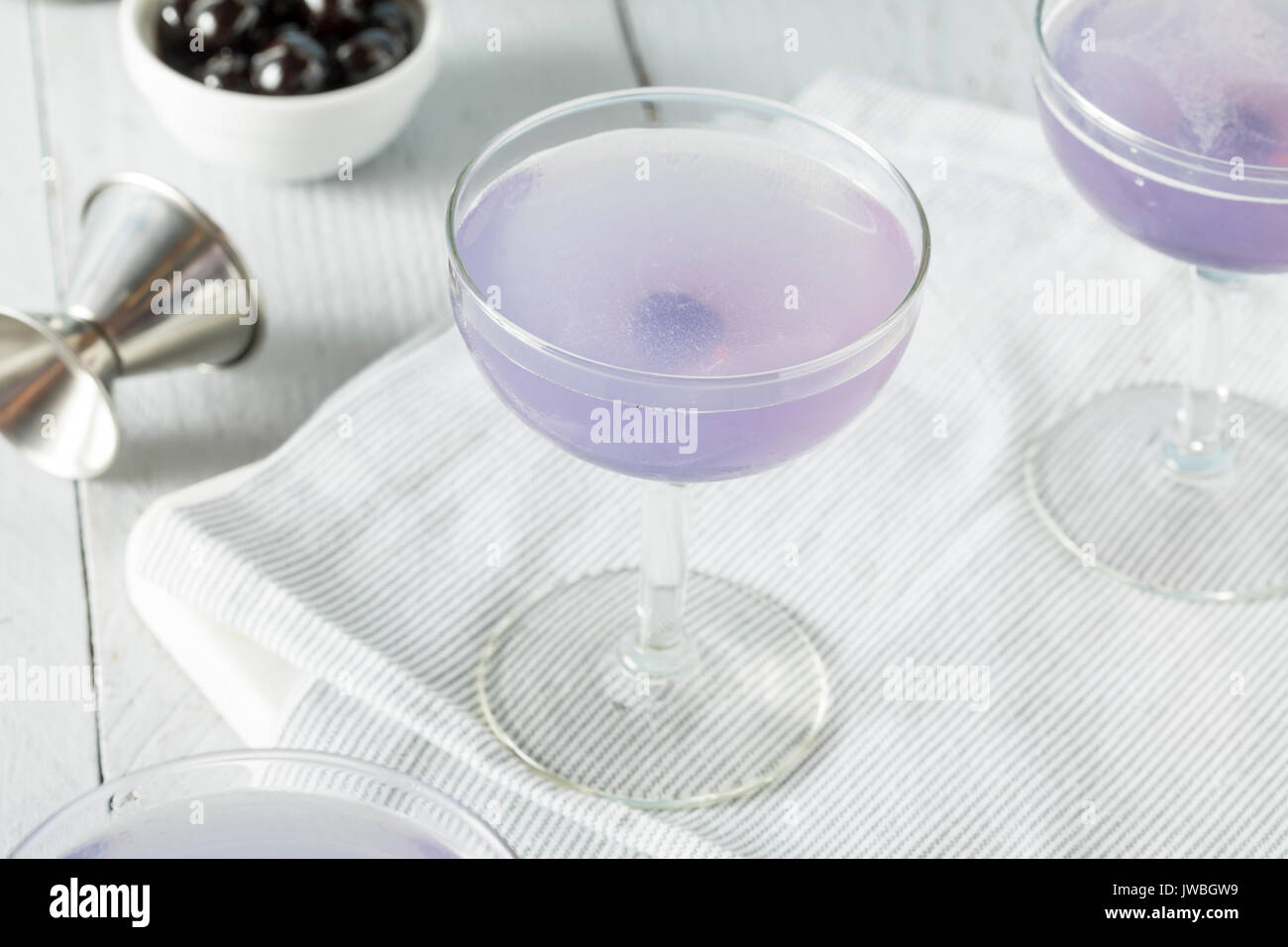 Sweet Violet Aviation Cocktail with a Cherry Garnish - Stock Image