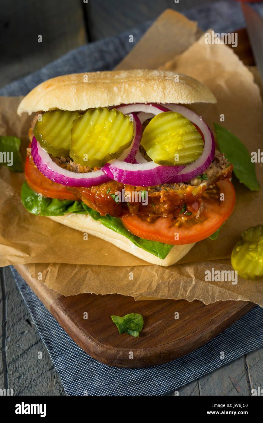 Homemade Savory Meatloaf Sandwich with Lettuce and Tomato - Stock Image
