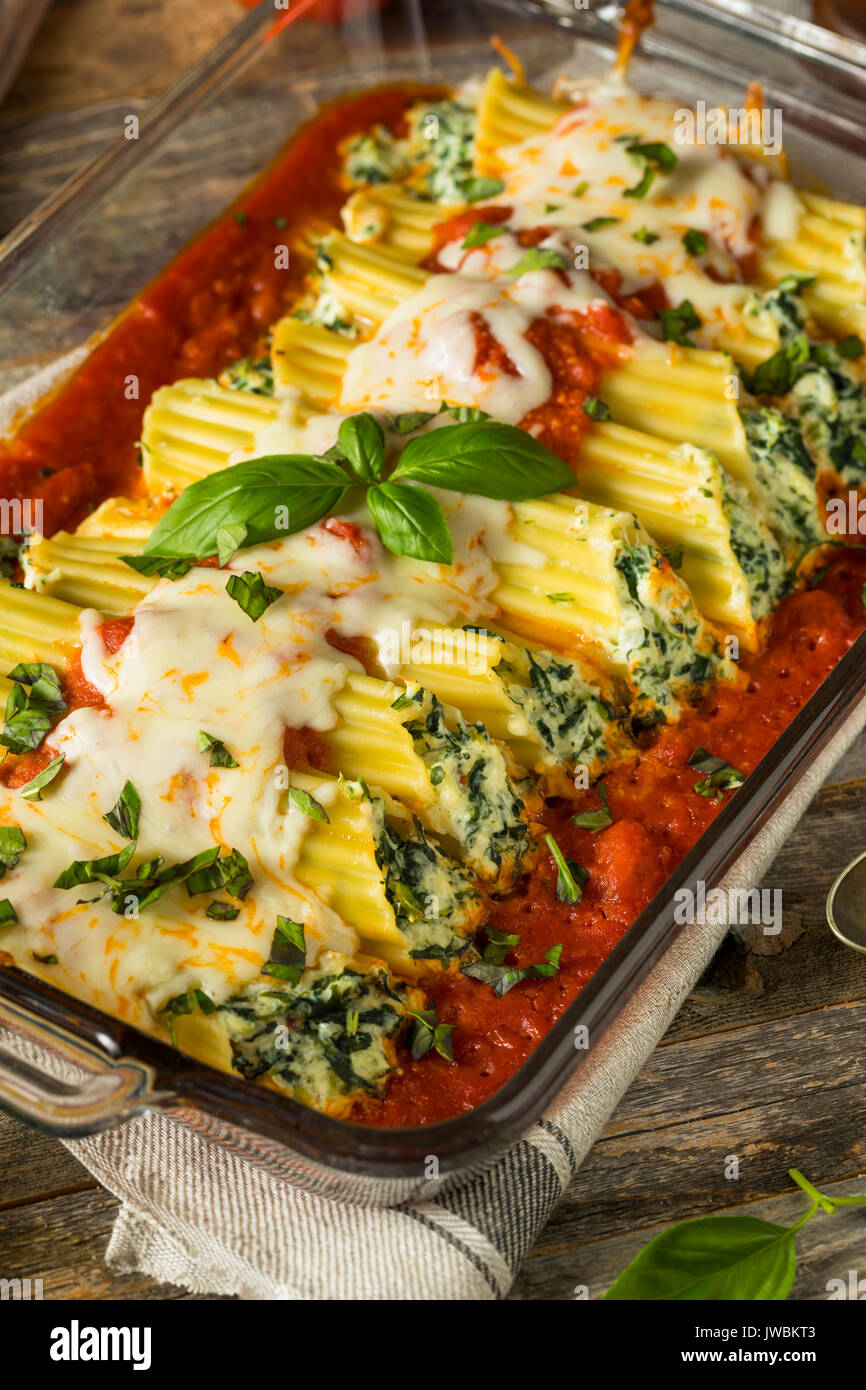 Homemade Stuffed Ricotta and Spinach Manicotti with Basil - Stock Image