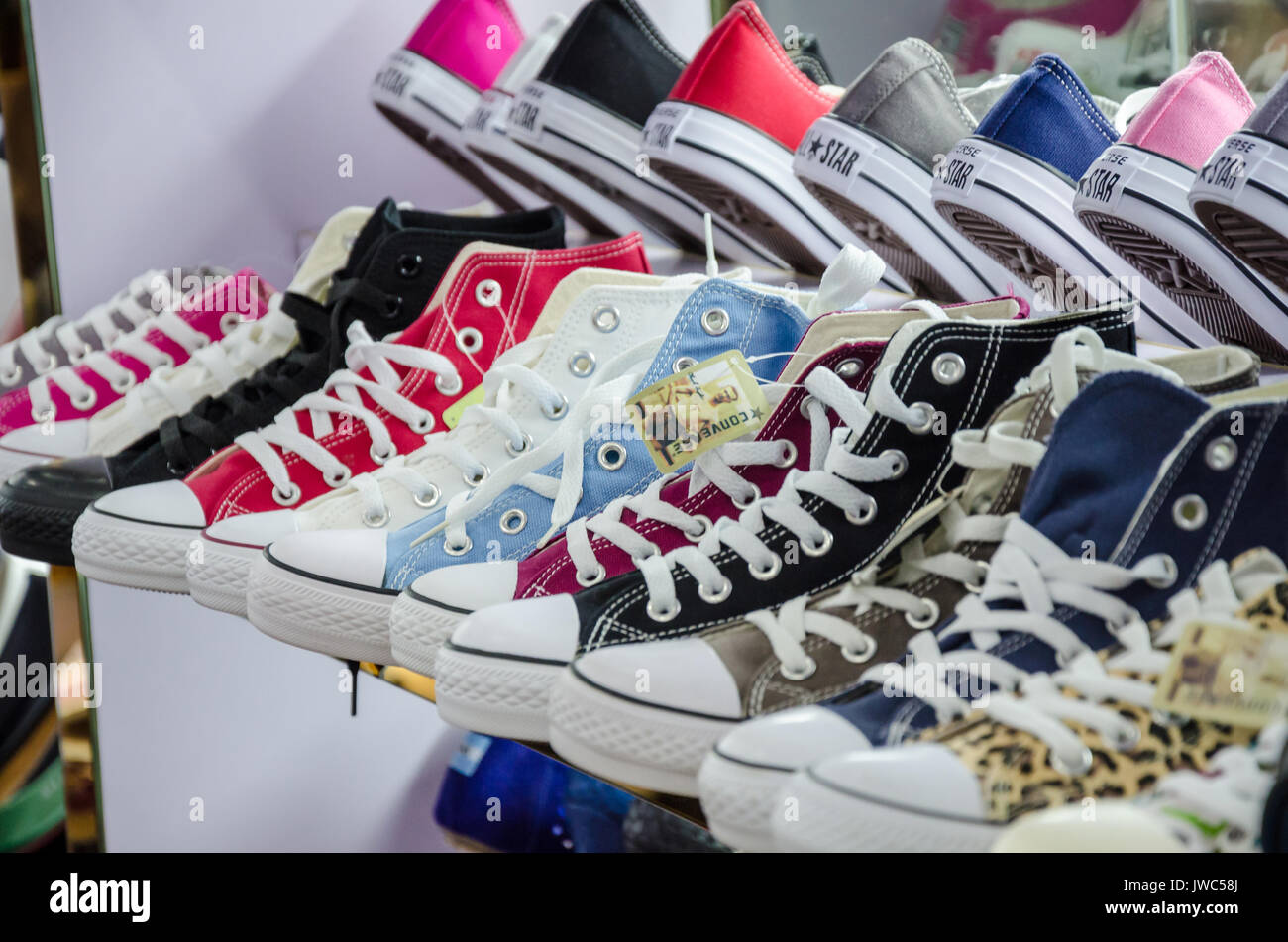 11182861c767 Converse shoes on display for sale in a shoe shop Stock Photo ...