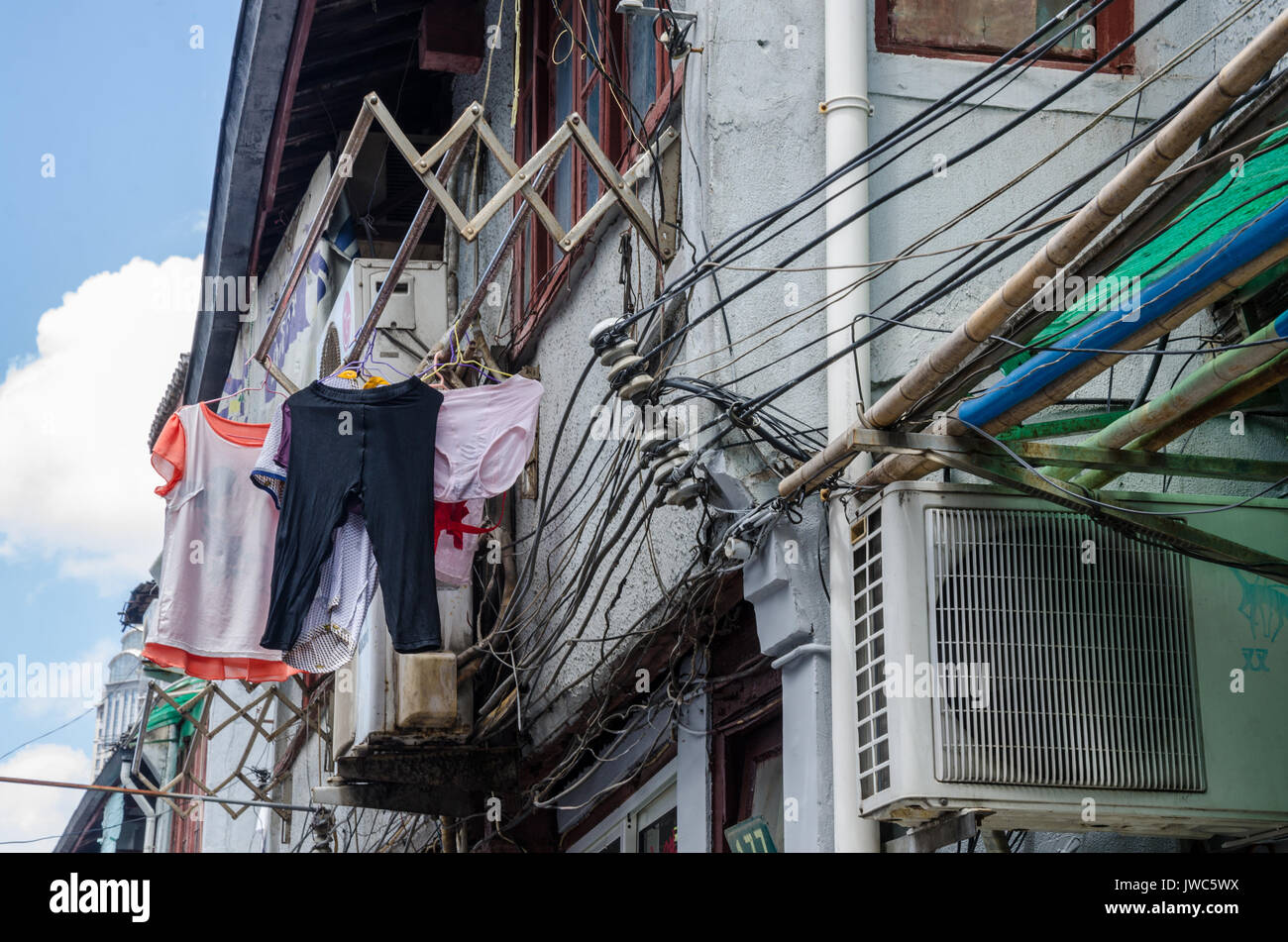 Clothes drying racks overhang the street from first floor windows ...
