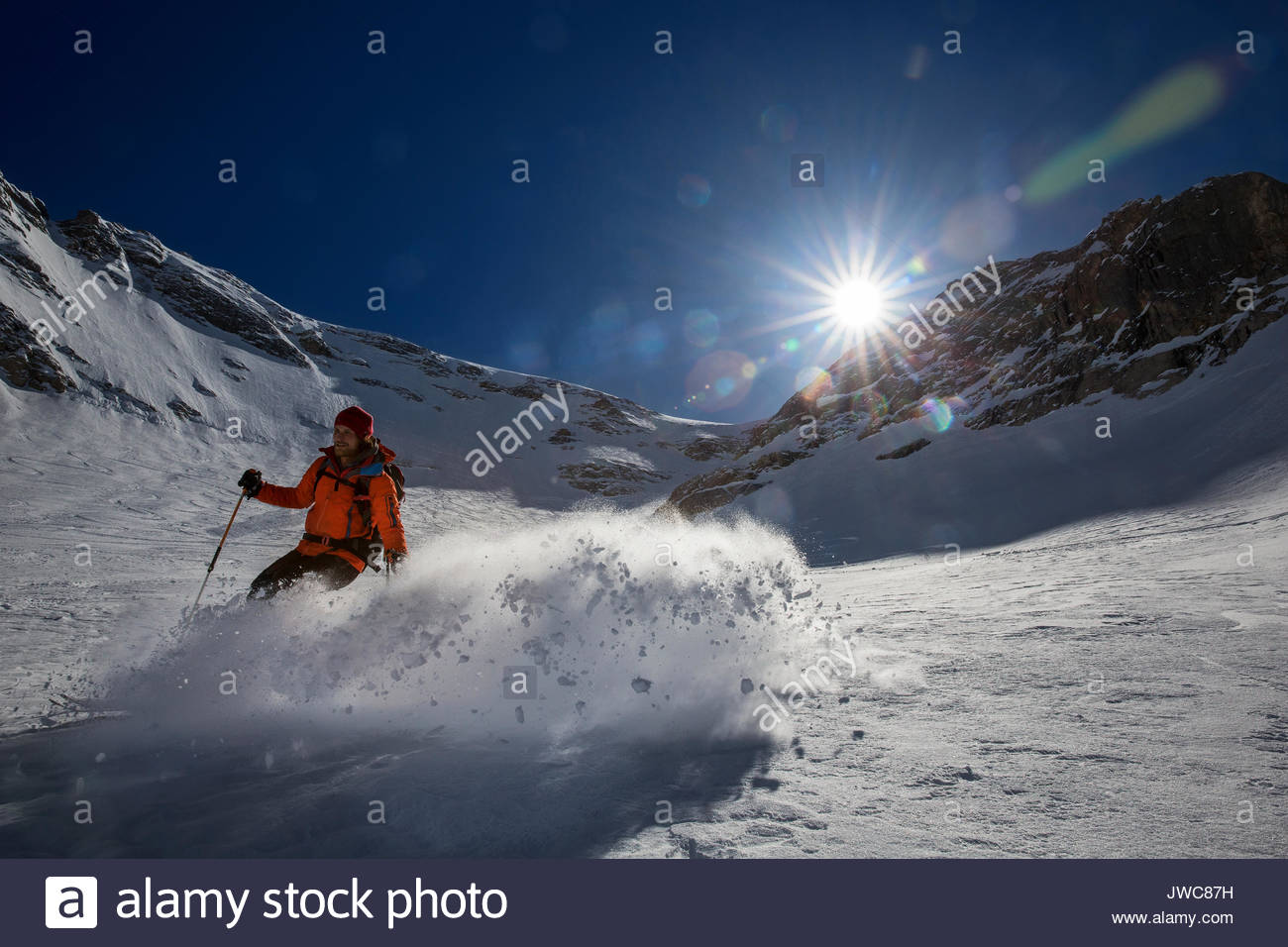 Skiing downhill near Marmolada. - Stock Image