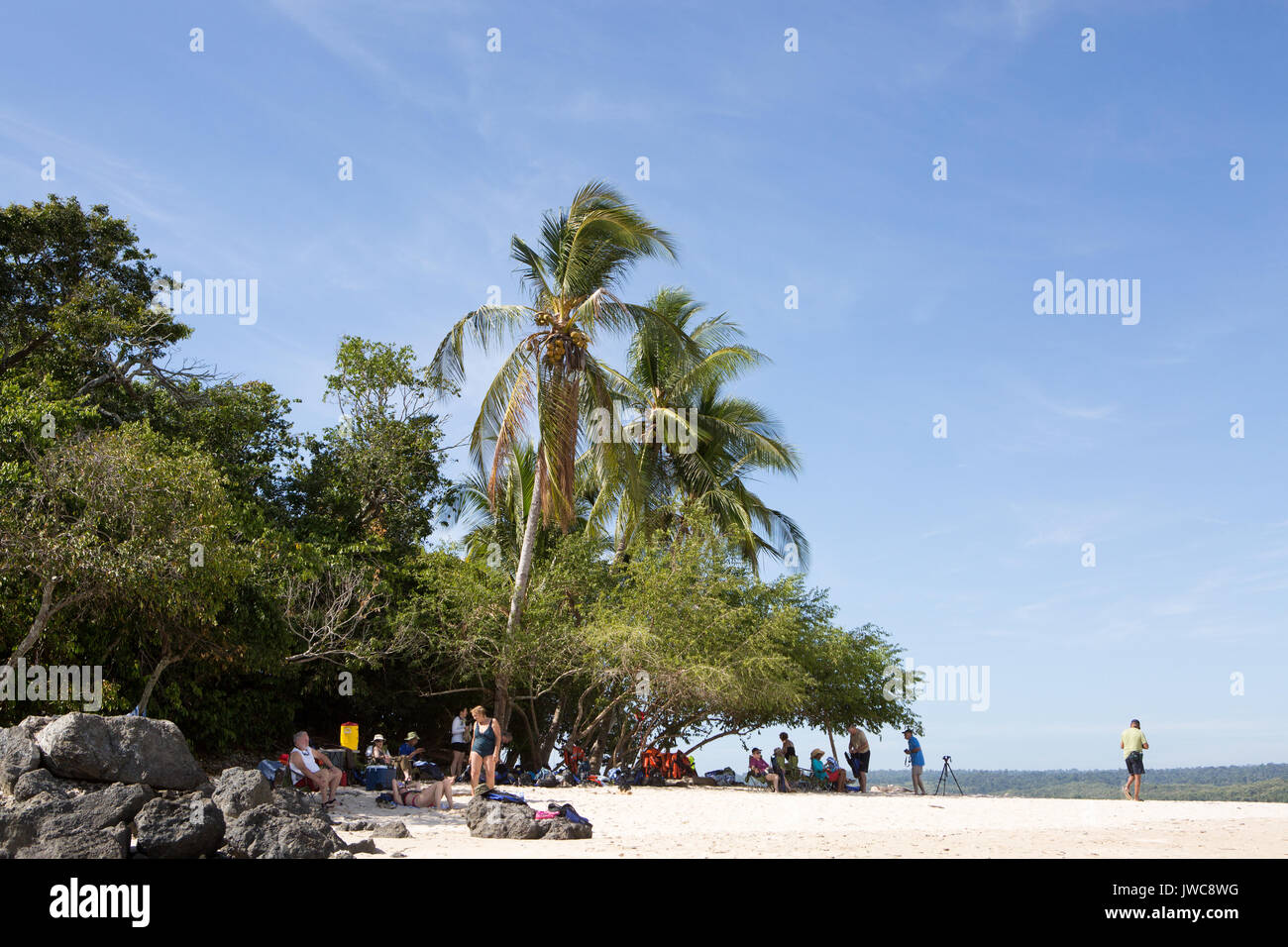 Visitors to Isla Granito de Oro,meaning Little Grain of Gold,sunbathe,relax and photograph on the small island. - Stock Image