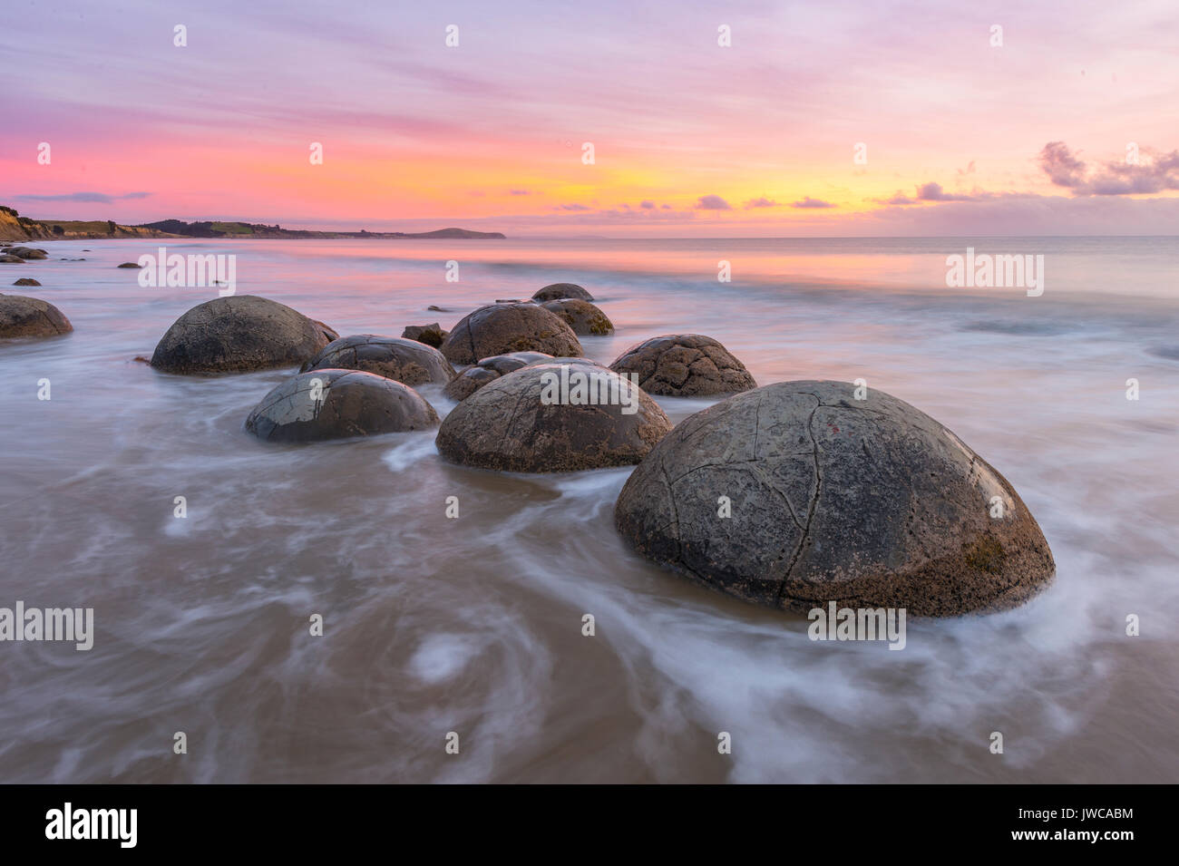 Moeraki boulders, at sunrise, geological formation, Koekohe Beach, Moeraki, East Coast, Otago, South Island, New Stock Photo