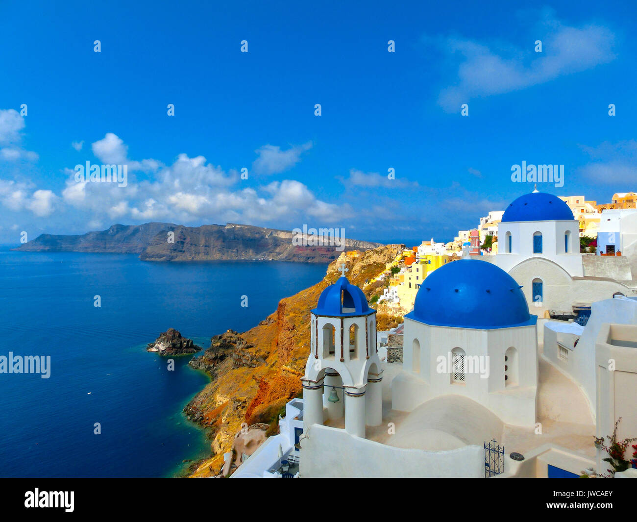 View to the sea from Oia village of Santorini island in Greece - Stock Image
