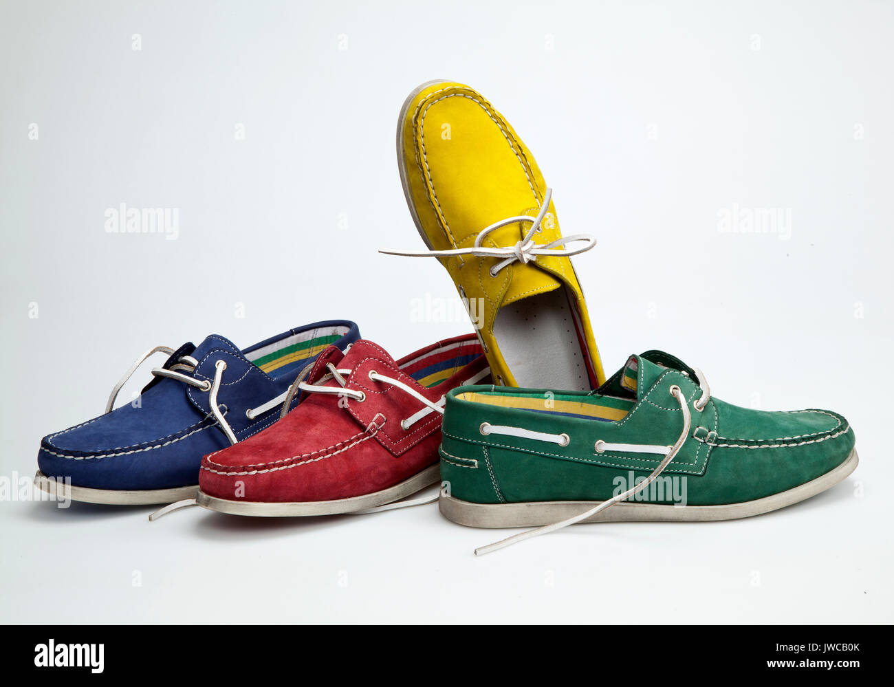 Colored shoes on white ground Stock Photo