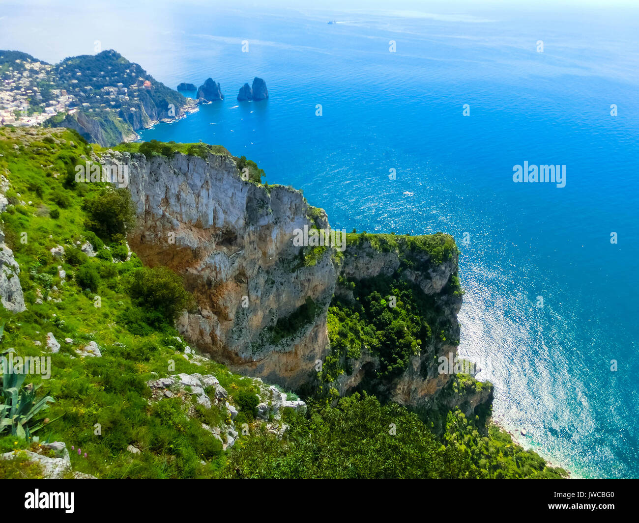 View from a cliff on the island of Capri, Italy, and rocks in sea - Stock Image