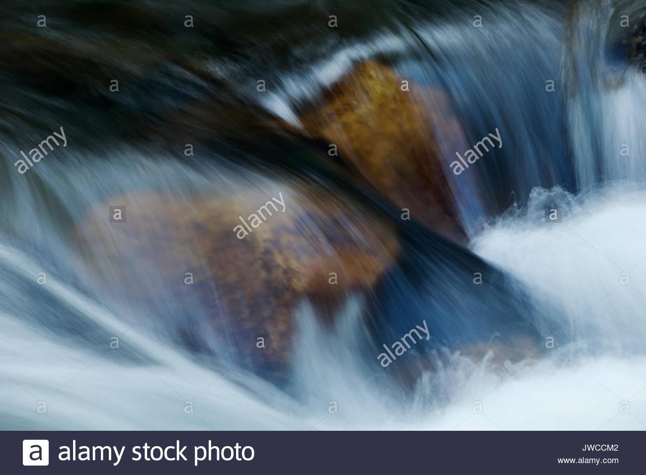 Close up of swiftly flowing water in Tenaya Creek. - Stock Image