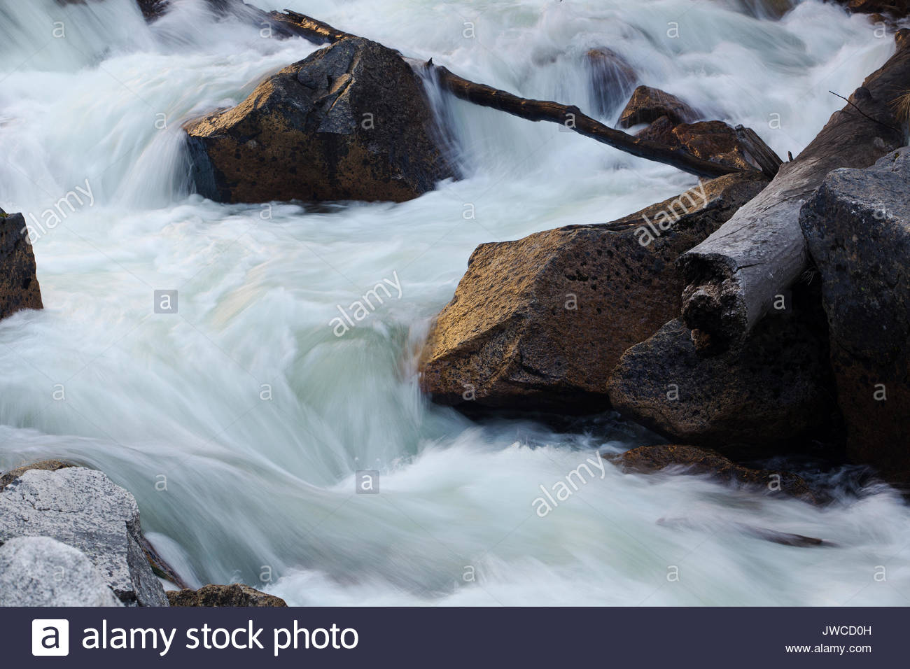 Close up of swiftly flowing currents in Tenaya Creek. - Stock Image