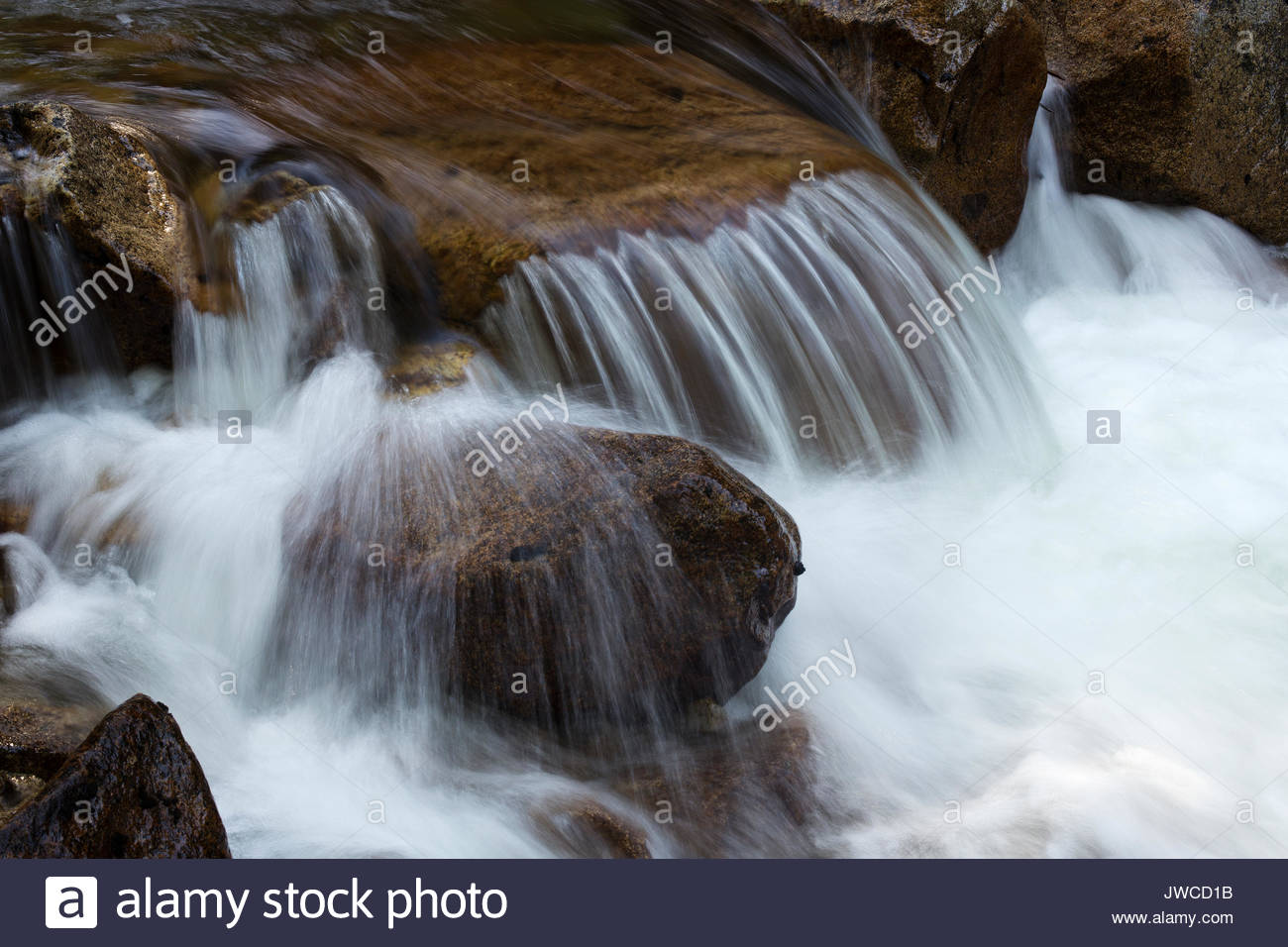Close up of cascading and swiftly flowing currents in Tenaya Creek. - Stock Image